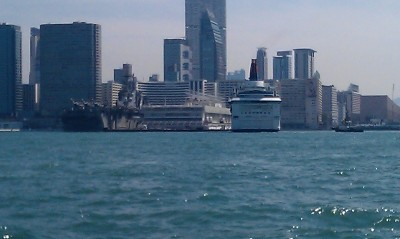 A cruise ship and a warship in Victoria Harbour