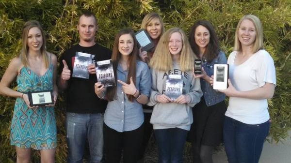 Here are 7 of my 8 siblings with copies of Seabound. The book is dedicated to them.
